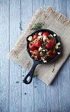 Oven-Baked Cherry Tomatoes with Garlic and Feta Stock Images