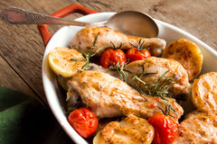 Oven baked chicken legs with vegetables Stock Photo