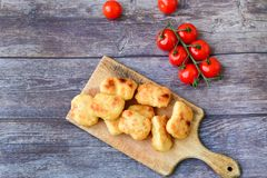 Oven baked chicken nuggets stock photos