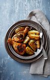 Oven-baked chicken and potatoes with pumpkin seeds Stock Image