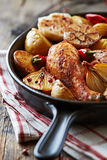 Oven-baked chicken with vegetables Royalty Free Stock Photography