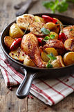 Oven-baked chicken with vegetables and herbs royalty free stock images