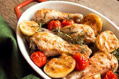 Oven baked chicken with vegetables Royalty Free Stock Photo