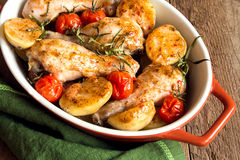 Oven baked chicken with vegetables Stock Photos