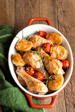 Oven baked chicken with vegetables Stock Images