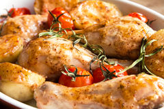 Oven baked chicken and vegetables Stock Image