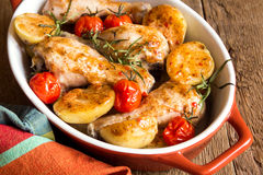 Oven baked chicken and vegetables Royalty Free Stock Image