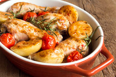 Oven baked chicken and vegetables Stock Photos