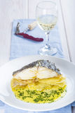 Oven baked cod fish with potatoes Royalty Free Stock Image