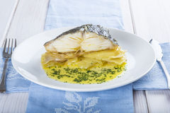 Oven baked cod fish with potatoes Stock Images