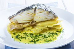 Oven baked cod fish with potatoes Stock Photos