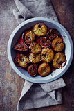 Oven-baked plums and figs with spices and honey Stock Image