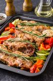 Oven baked pork entrecotes with bell pepper and zucchini. royalty free stock photo