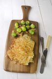 Oven baked potato crusted cod fillet Stock Image