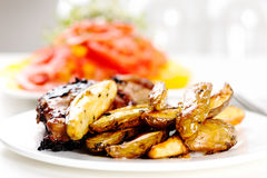 Oven baked potato with grilled chicken Royalty Free Stock Photo