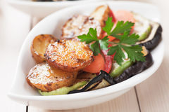 Oven baked potato and grilled vegetable. Oven baked spicy potato with grilled vegetables, healthy vegan meal Stock Images