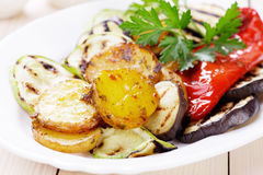 Oven baked potato and grilled vegetable. Oven baked spicy potato with grilled vegetables, healthy vegan meal Royalty Free Stock Photo