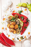 Oven baked potato and grilled vegetables. Oven baked spicy potato with grilled vegetables, healthy vegetarian dish Stock Photography
