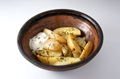 Oven baked potato with rosemary. Oven-baked fresh potato with rosemary earthen pot Royalty Free Stock Images
