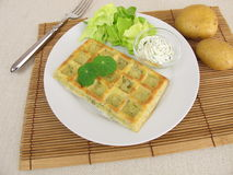 Oven-baked potato waffles with cream cheese dip Royalty Free Stock Photo
