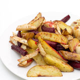 Oven baked potatoes, beetroot, celeriac and garlic Royalty Free Stock Photography