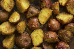 Oven baked potatoes close up Stock Images