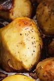 Oven baked potatoes closeup Stock Photography
