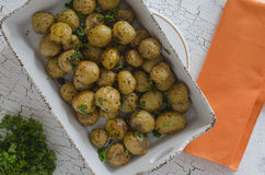 Oven baked potatoes. Rustic oven baked potatoes with parsley Stock Image