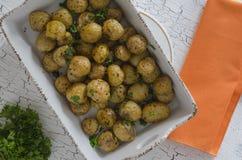 Oven baked potatoes stock image