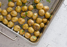 Oven baked potatoes. Rustic oven baked potatoes with parsley Royalty Free Stock Photos