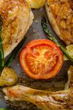 Oven-baked chicken with vegetables on the roasting tray Stock Photography