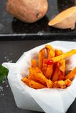 Oven Baked Sweet Potato Fries. Homemade oven baked sweet and juicy, sweet potato fries. Ketchup and sea salt stock photography