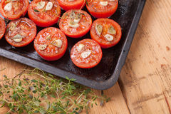 Oven baked tomatoes. With garlic and thyme Royalty Free Stock Photography