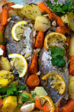 Oven baked trout and vegetables Stock Photo