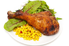 Oven baked turkey leg served with salad and corn Royalty Free Stock Image