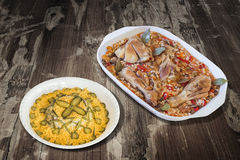 Oven Baked Vegetable Stew with Chicken Meat and Bowl of Garnished Russian Salad set on Old Weathered Wooden Garden Table Royalty Free Stock Images