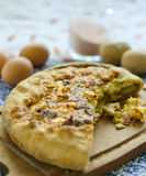Oven baked vegetables and eggs tart. On a wooden board, closeup Royalty Free Stock Photo
