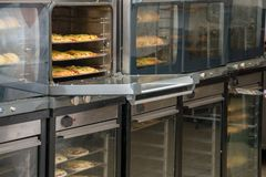 Bakery products on display. Oven with bakery trays. industrial production of bread bakery products stock photo