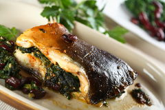 Oven carp with spinach Stock Images