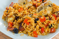Oven chicken with rice, vegetables and black olives Stock Photo
