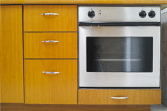 Oven cooker. Front view of gas oven cooker with closed door in the kitchen Stock Photography