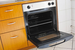 Oven cooker lateral view. Side view of gas oven cooker with open door Royalty Free Stock Image