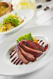 Oven crisp duck breast marinated in sauce royalty free stock images