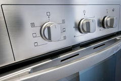 Oven dial. Dial of a stainless steel electric oven Stock Image