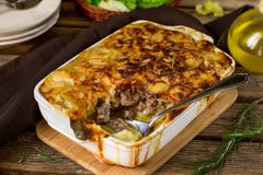 Oven dish potato gratin with minced beef and bechamel sauce. Oven dish potato gratin casserole with minced beef and bechamel sauce Stock Images