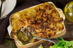 Oven dish potato gratin with minced beef and bechamel sauce. Oven dish potato gratin casserole with minced beef and bechamel sauce Stock Photography