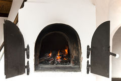 Oven with fire Royalty Free Stock Image
