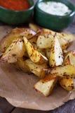 Oven geroosterde aardappelwiggen Stock Afbeeldingen