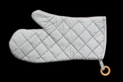 Oven glove. Single grey oven glove isolated on black background Royalty Free Stock Images
