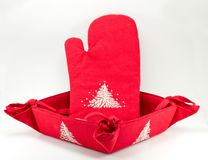 Oven glove and bread basket Royalty Free Stock Images